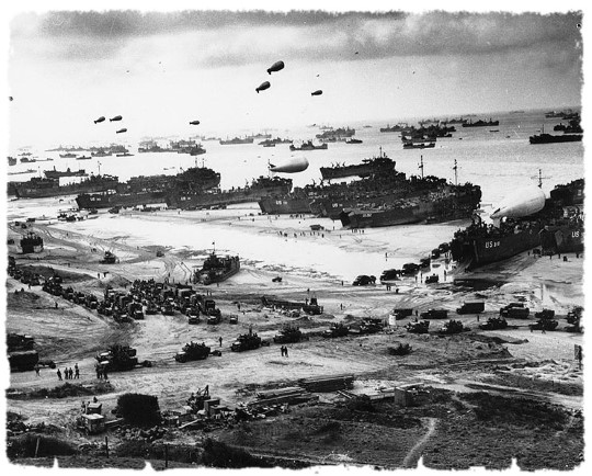 Thousands of troops, landing vehicles and cargo on a Normandy Beach 6 June 1944