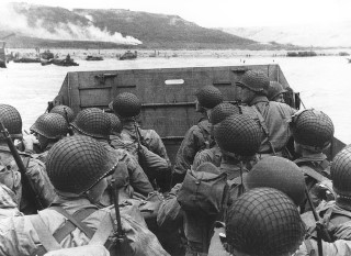 Army Troops wade ashore on