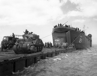 Unloading British Tanks and Trucks off Normandy 6 June 1944